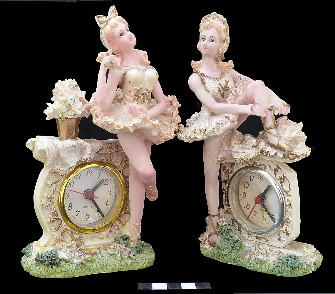 Two electric clocks with ballerina figures